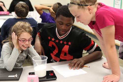Middle School STEM students conducting an experiment