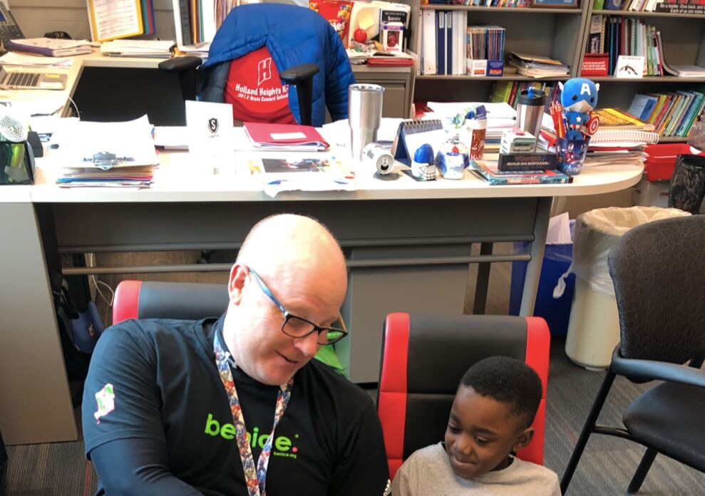 Kevin Derr reading with a student